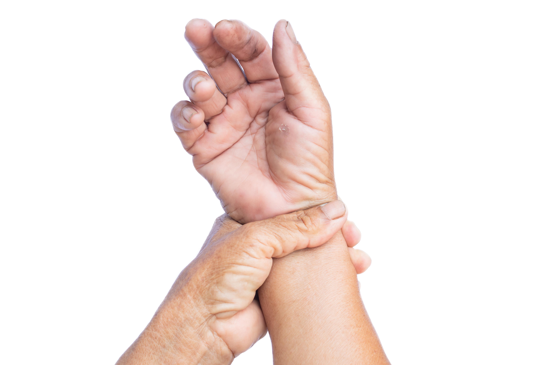 patient holding wrist